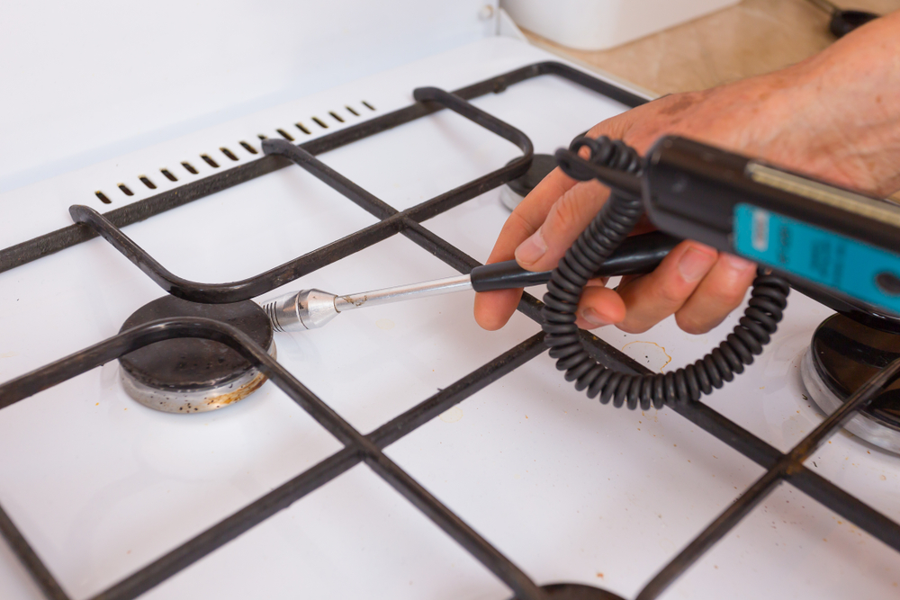 Man Checking For Leaks With Gas Leak Detection Tool